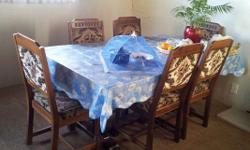Good quality wood dining table and 6 chairs for sale.
