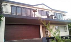 Contemporary home on 2 levels with balcony, decking and